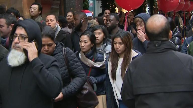 Shoppers queue outside Harrods in Knightsbridge on Boxing Day