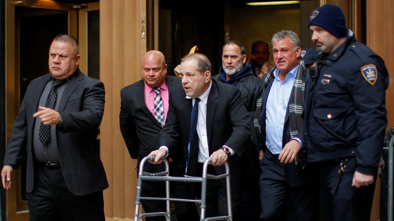Harvey Weinstein is flanked by bodyguards as he leaves a bail hearing on Wednesday