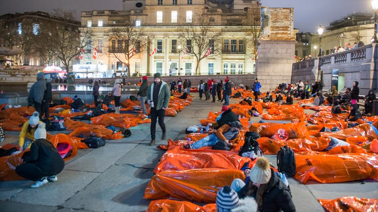 Members of the public sleeping outside overnight in survival bags at Trafalgar Square