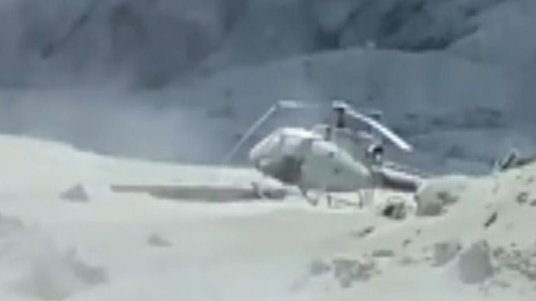 The video shows a helicopter on the ground, damaged by the ash cloud. Pic: Twitter / @Sch