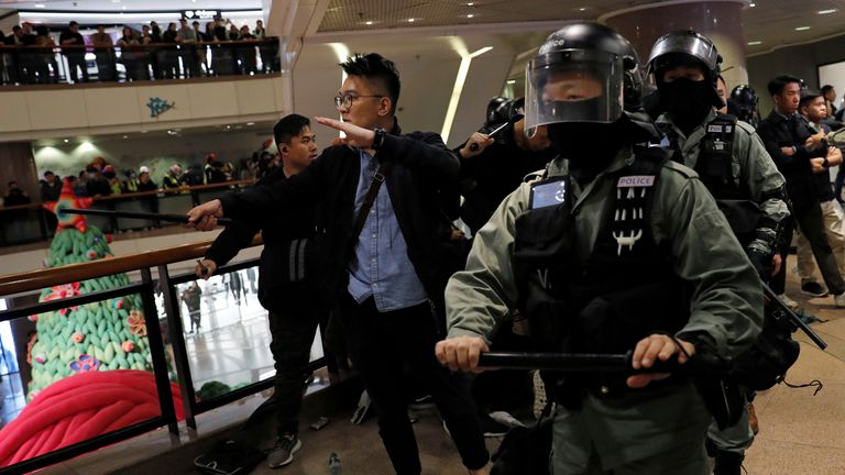 Riot police arrive to disperse anti-government demonstrators protesting inside a shopping mall on Christmas Eve in Hong Kong, China, December 24, 2019