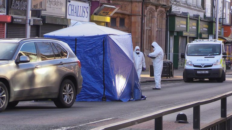 Police forensic officers attend the scene on Hessle Road, Hull