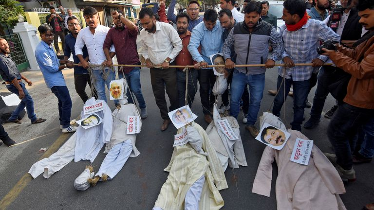 Protesters carry effigies during a protest
