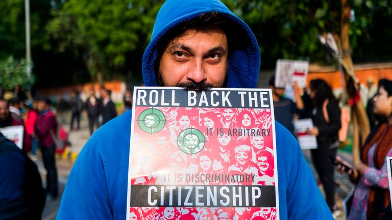 A protester displays a placard during a demonstration against the Indian government's new law