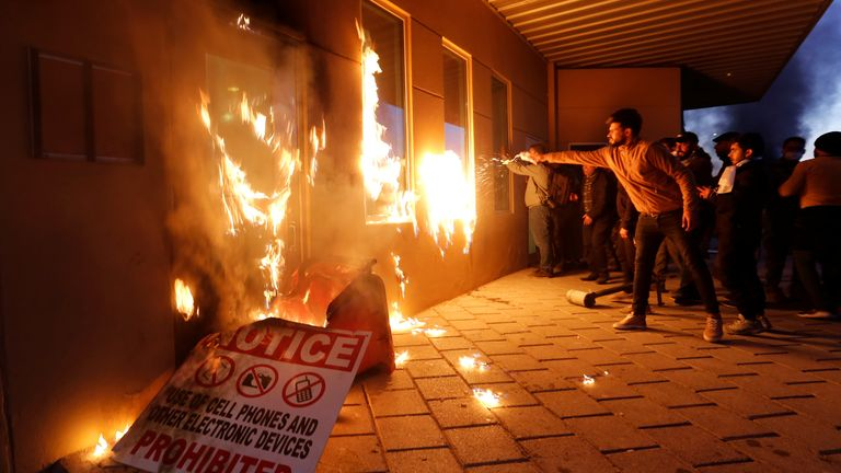 Protesters set fire to a reception building in the compound