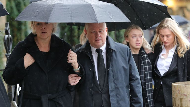 Jack Merritt's parents Anne and David, and girlfriend Leanne O'Brien (centre) arrive for the funeral