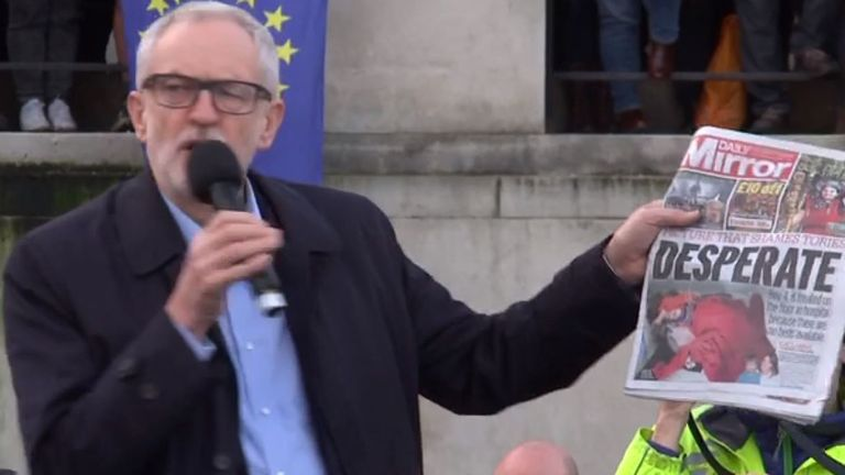 Jeremy Corbyn holds up a copy of the Daily Mirror with a photo of Jack Williment-Barr