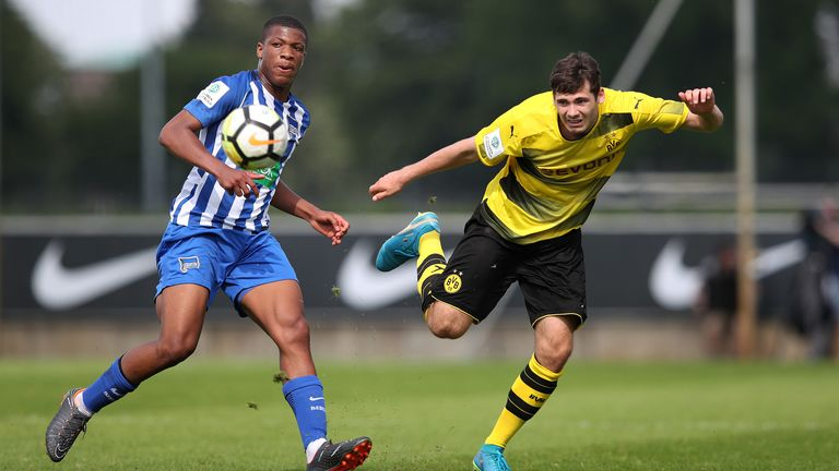 Jessic Ngankam (L) of Hertha BSC and Tim Sechelmann (R) of Borussia Dortmund
