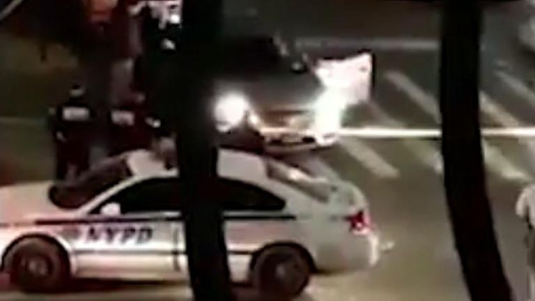 The video shows the scene in Harlem where the possible suspect was detained.