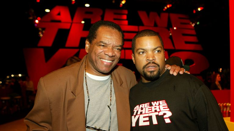 "Actors John Witherspoon and Ice Cube pose at the after party of the premiere of ""Are We There Yet"" at Barker Hanger on January 9, 2005 in Santa Monica, California. (Photo by Kevin Winter/Getty Images)"