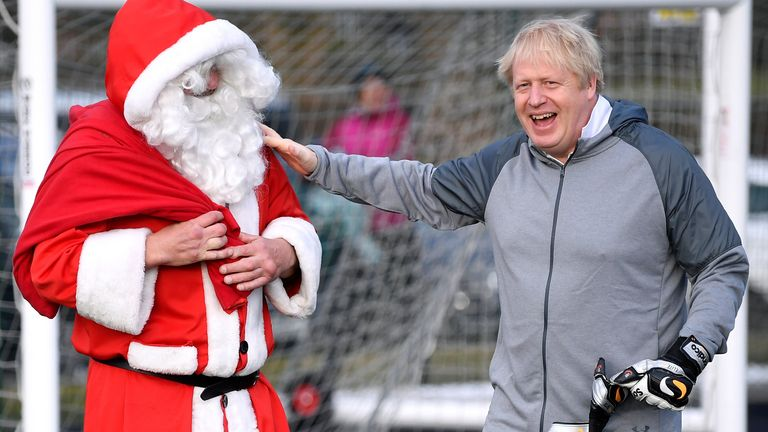 Boris Johnson jokes with Santa in Cheadle Hulme