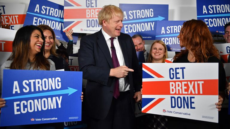 Boris Johnson has an exchange with a supporter at a rally