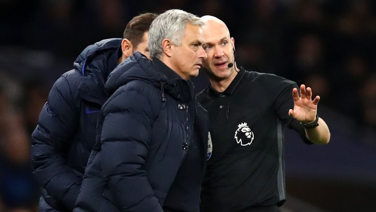 Referee Anthony Taylor talks to Tottenham manager Jose Mourinho