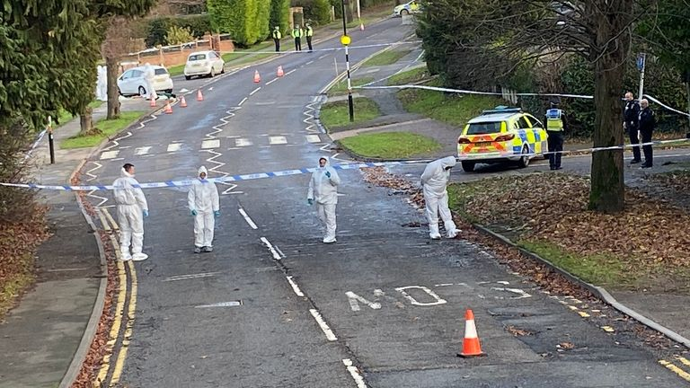 Forensic officer search the scene of the fatal stabbing. Pic: NorthantsTST