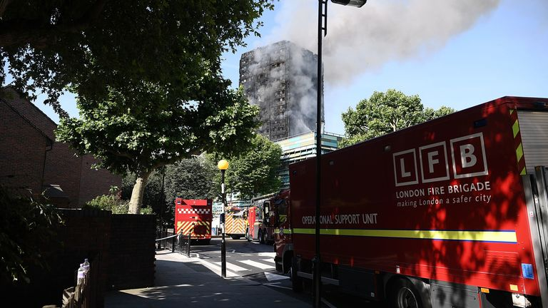 Fire brigade vehicles are parked near Grenfell Tower in the hours after the blaze in June 2017
