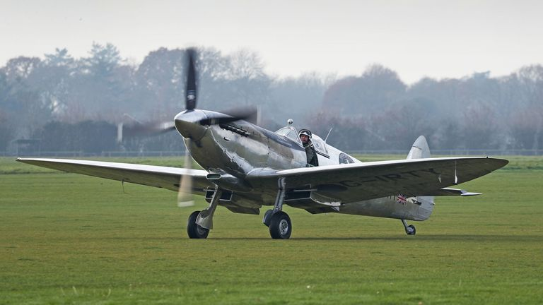 The IWC MK IX Silver Spitfire landing at Goodwood Aerodrome after