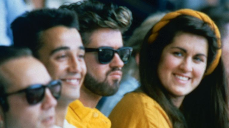 George Michael with Andrew Ridgeley and sister Melanie Panayiotou at Live Aid in 1985
