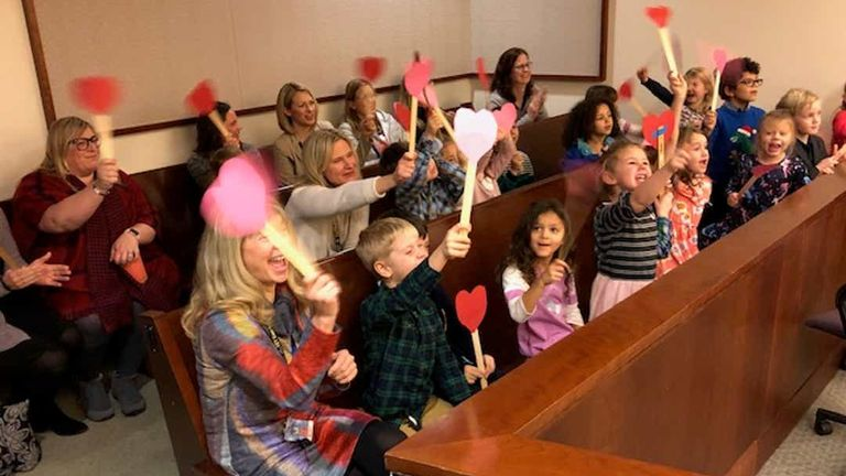 Michael's friend waved paper hearts when the adoption became official. Pic: Kent County Court
