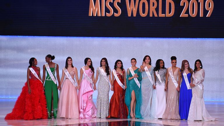 The twelve finalists line up during the Miss World Final 2019