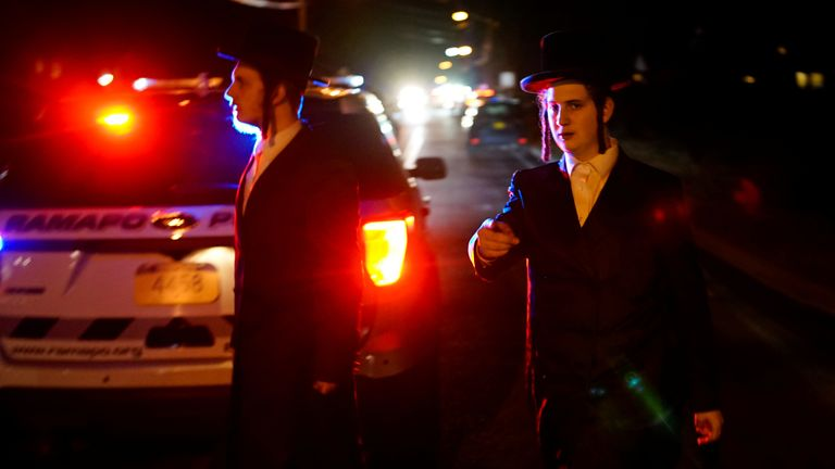 Jewish people try to reach the area where five people were stabbed at a Hasidic rabbi's home in Monsey