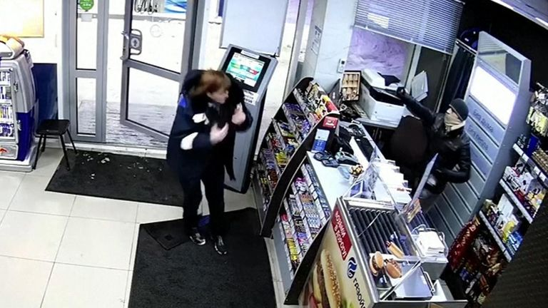 Employee at Siberian petrol station fights of masked robber who used pepper spray to steal from the cash register