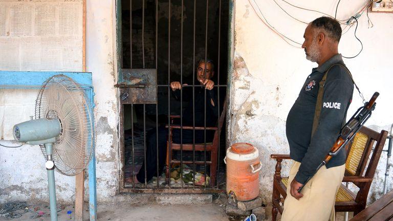 Dr Muzaffar Ghangro is seen behind bars after his arrest