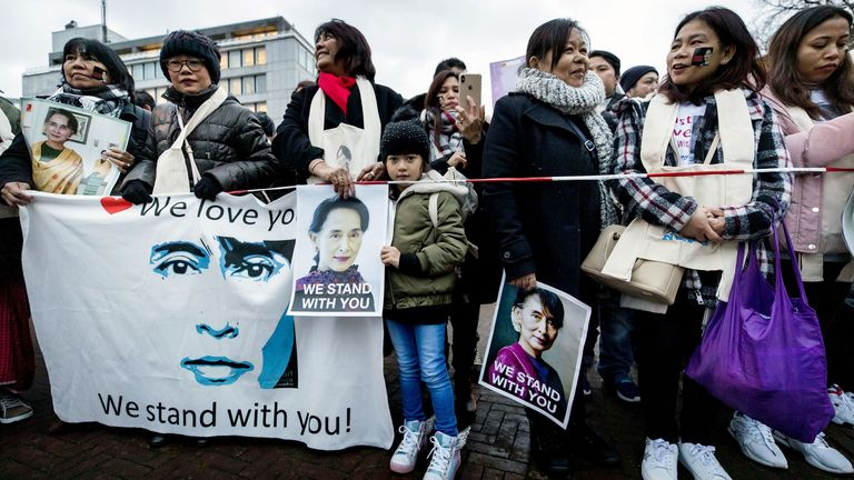 Protesters support Myanmar's State Counsellor Aung San Suu Kyi stand in front of the Peace Palace of The Hague