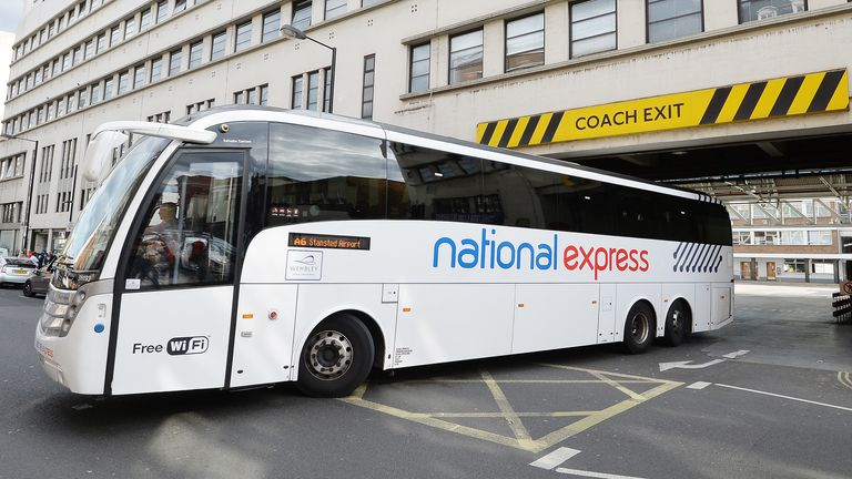 A National Express coach leaves the Victoria Coach Station, in central London.