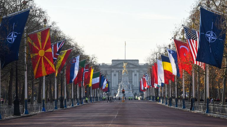 LONDON, ENGLAND - DECEMBER 03: NATO member country flags fly on the Mall in front of Buckingham Palace on December 3 2019 in London, England.