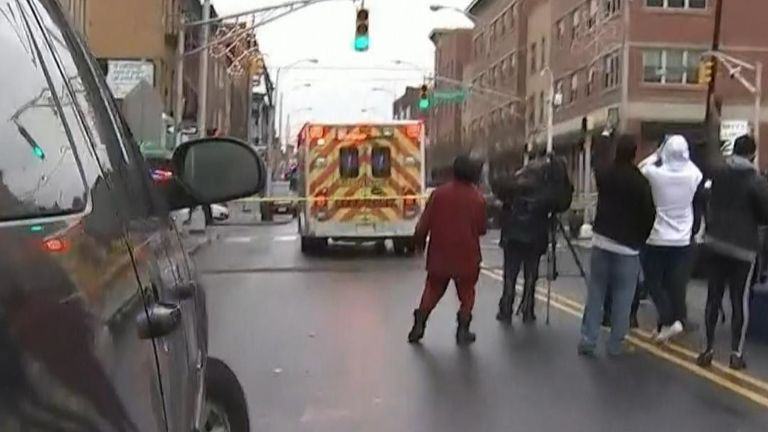 Gunfire interrupts live broadcast as news crew retreats from police line in Jersey City