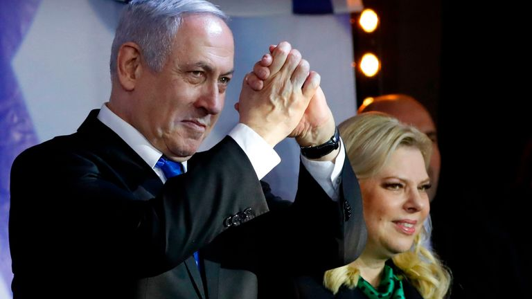 Israeli Prime Minister Benjamin Netanyahu, accompanied by his wife Sara, addresses Likud party supporters during an electoral meeting in the Israeli city of Petah Tikva near Tel Aviv on December 18, 2019