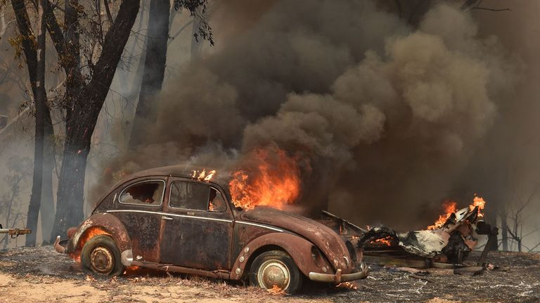Fire burns through a car in New South Wales