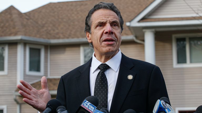 New York Governor Andrew Cuomo outside the home of a rabbi where five people were stabbed by a man armed with a knife