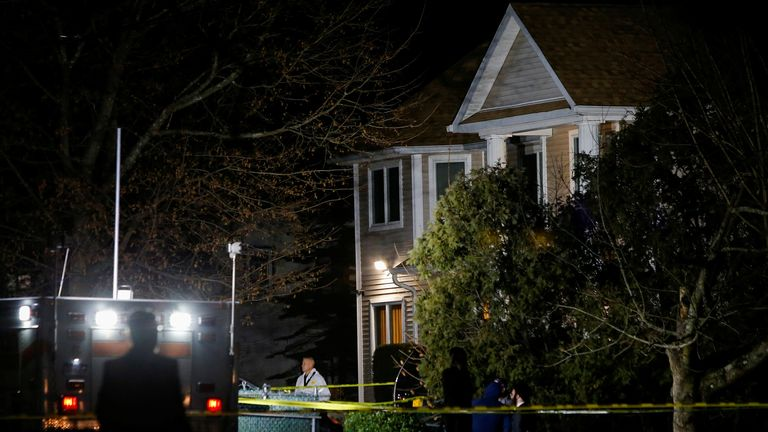 Police outside the home of a Hasidic rabbi's home in Monsey, New York, wherer five people were stabbed