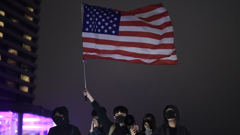 Protesters hold up a US flag in Hong Kong during New Year's Eve celebrations