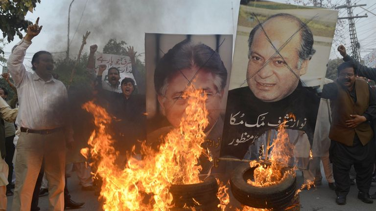 Protesters burn images of Musharraf and then PM Nawaz Sharif in 2016