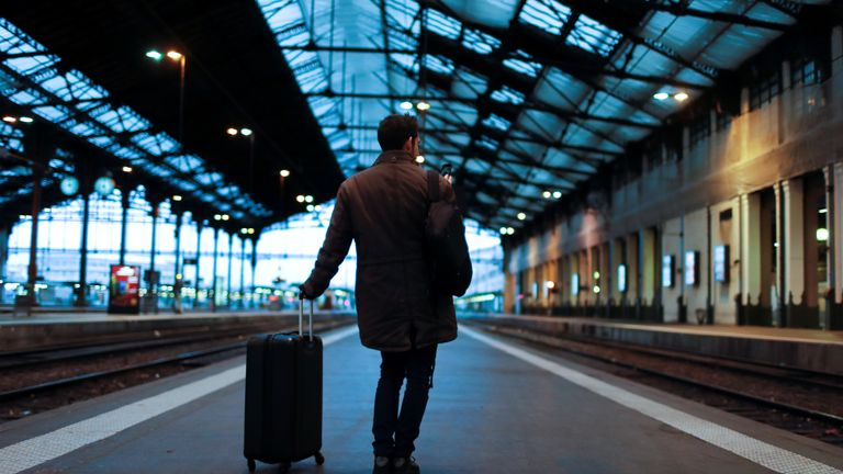 A traveler waits for a train at Gare de Lyon train station in Paris