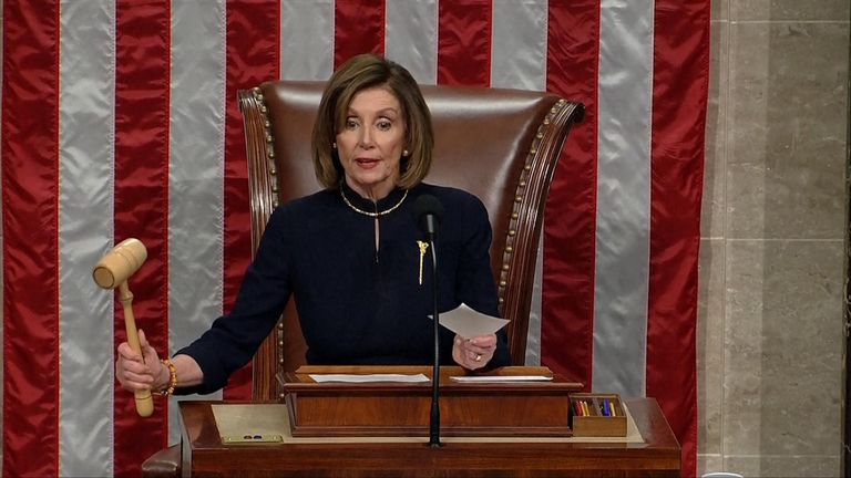 House majority leader Nancy Pelosi brings down the gavel on the first vote to impeach President Trump