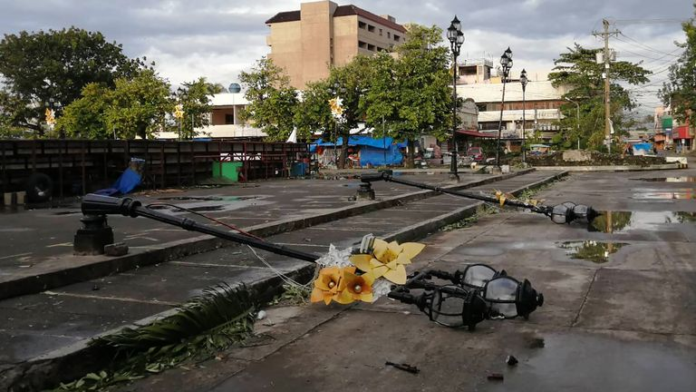 Lamp posts damaged due to typhoon Phanfone lie on a road in Ormoc City, Leyte province in central Philippines on December 25, 2019