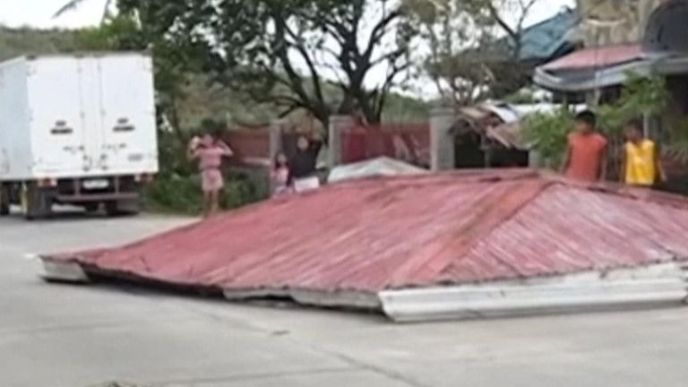 Typhoon Phanfone has taken the roof off a building in the Philippines