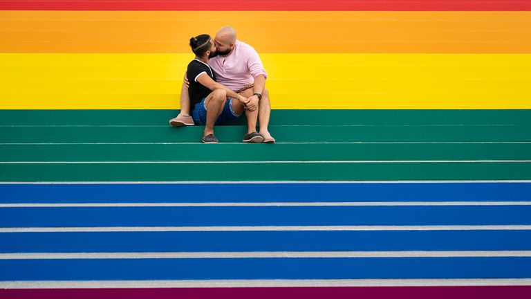 Jesus Tavarez and Juan De La O, both from The Bronx, New York, kiss on the steps that are covered in rainbow colours for Pride Month at Franklin D. Roosevelt Four Freedoms Park in New York City