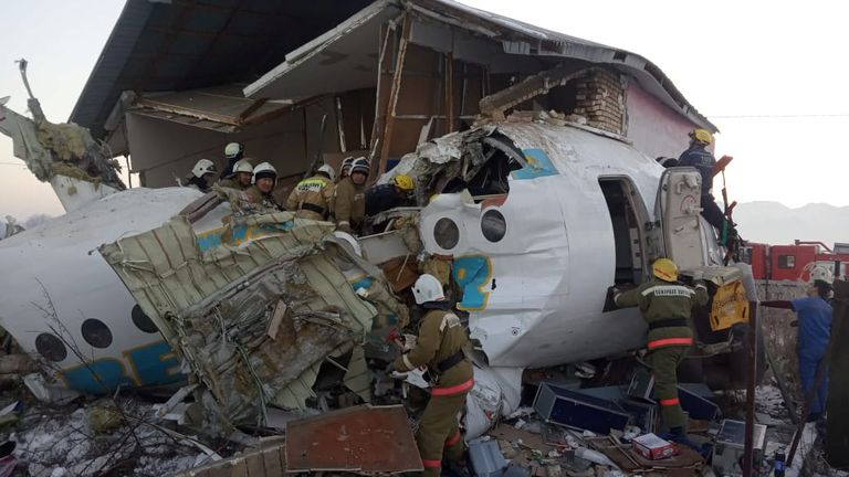 Emergency and security personnel are seen at the site of the plane crash near Almaty, Kazakhstan, December 27, 2019. Emergency Committee of Ministry of Internal Affairs of Kazakhstan