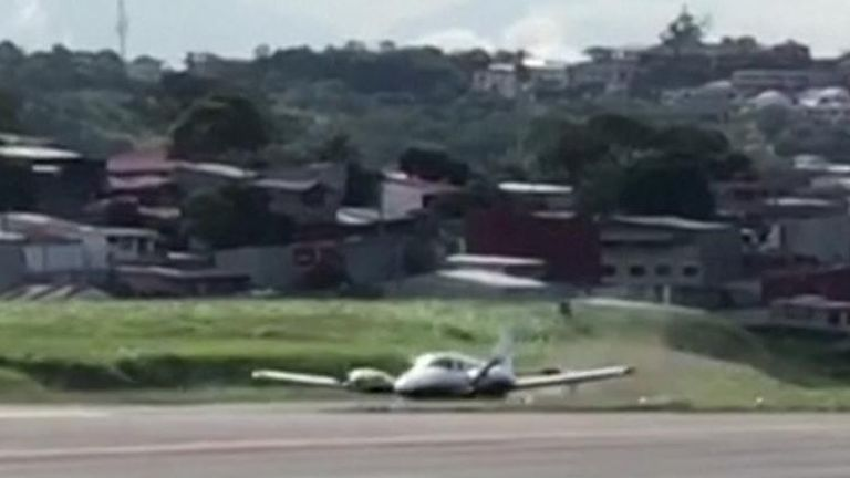 Four American tourists escaped serious injury after their plane blew its tyres, skidding to a stop on the runway.