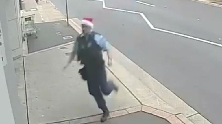Police in New South Wales wear Santa hats while chasing a suspect