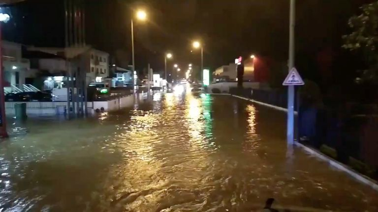 A flooded street is pictured as Storm Elsa sweeps through Trofa, in Porto, Portugal