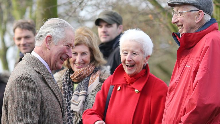 The Prince of Wales speaks to local residents during a visit to Fishlake, in South Yorkshire, which was hit by floods earlier this year.  PA Photo. Picture date: Monday December 23, 2019. A month's worth of rain fell in just 24 hours which left over 25 roads and four bridges closed and approximately 1,000 residential properties were flooded or became uninhabitable. See PA story ROYAL Charles. Photo credit should read: Nigel Roddis/PA Wire