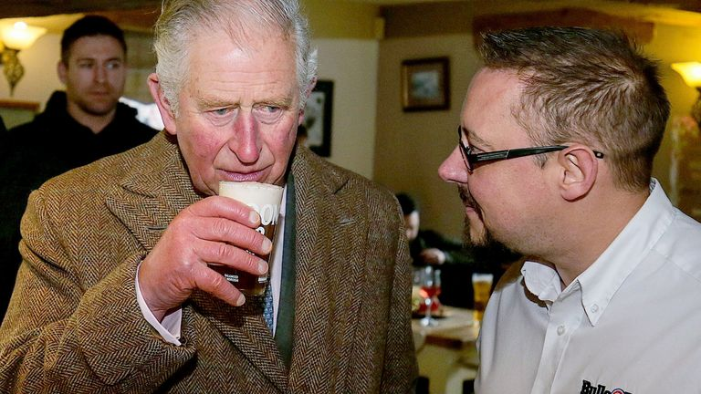 The Prince of Wales has a drink in the Hare and Hounds pub during a visit to Fishlake, in South Yorkshire, which was hit by floods earlier this year.  PA Photo. Picture date: Monday December 23, 2019. A month's worth of rain fell in just 24 hours which left over 25 roads and four bridges closed and approximately 1,000 residential properties were flooded or became uninhabitable. See PA story ROYAL Charles. Photo credit should read: Nigel Roddis/PA Wire
