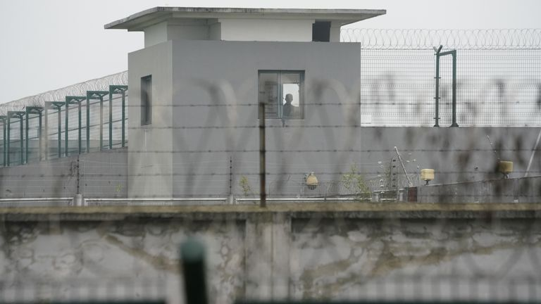 A man is seen in a building of Qingpu Prison