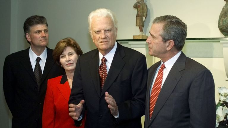 The late Rev Billy Graham, his son Billy (L) and former US President George W Bush with his wife Laura, November 2000