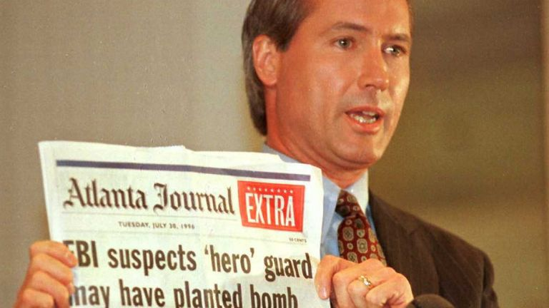 Richard Jewell Attorney Lin Wood holds a copy of the Atlanta Journal during a press conference 28 October 1996. Wood said Jewell plans to file suit against several media sources for defamation of character